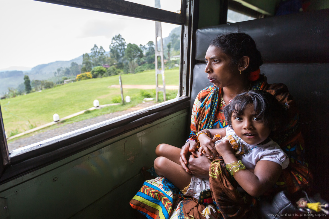 Local mother and child riding the train