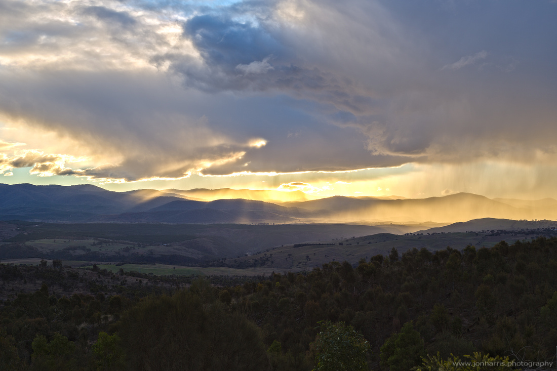 Rain shower over the Brindabella mountains from Mt Stromlo